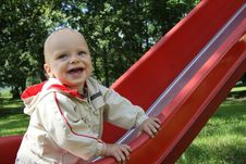 Baby On A Slide Royalty Free Stock Photo