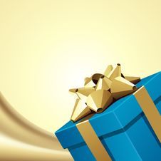 Blue Gift With Gold Bow On Silk Royalty Free Stock Photos
