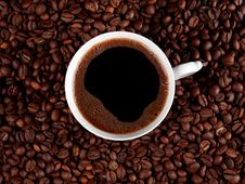 Free Cup Of Coffee Isolated On Roasted Coffee Beans Stock Photos - 17552083