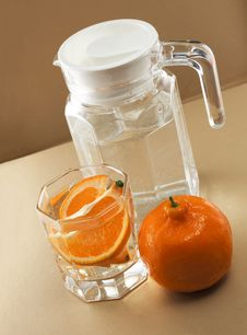 Oranges And Glass Cups Stock Image