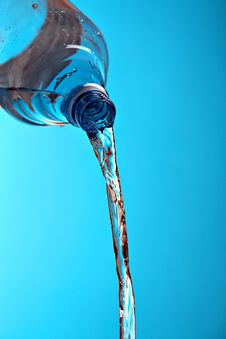 Free Water Runs Out Of Plastic Bottle Royalty Free Stock Photos - 17556268
