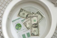 Free Dollars Getting Ready To Be Flushed Down The Toile Stock Photos - 17559363