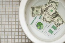 Free Dollars Getting Ready To Be Flushed Down The Toile Stock Photography - 17559402