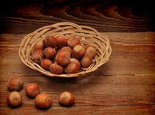 Free Wood Nuts In A Basket Royalty Free Stock Photography - 17561217