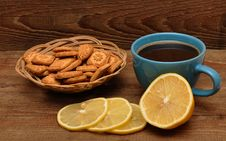 Free Cup Of Tea With Lemon And Cookies In Basket Royalty Free Stock Photo - 17561245