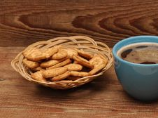 Cup Of Tea And Cookies In Basket Stock Photography