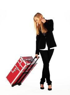Business Girl And Her Suitcase Royalty Free Stock Image
