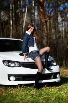Free Young Stylish Woman And White Power Car Royalty Free Stock Photo - 17562935