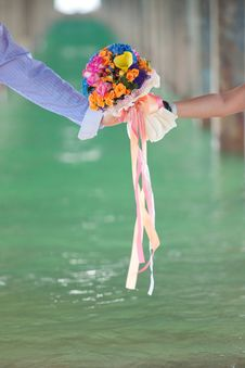 Two Hand Holding Beautiful Flower Bouquet Stock Images