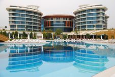 Luxury Hotel With Reflection In The Pool. Stock Photo