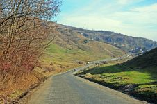 Curved Road On Hills Royalty Free Stock Photo