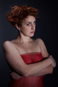 Free Portrait The Red Girl Against A Dark Background Stock Image - 17572451