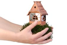 Clay House On Moss In Hands Stock Image