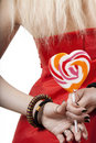 Free Blonde In A Red Dress Holds Lollipop Stock Images - 17587064
