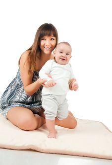 Free Pretty Young Women And Her Baby Stock Photography - 17584332