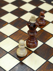 Wooden Chess Figures On Game Board Royalty Free Stock Photo
