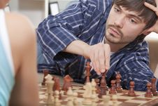 Couple Playing Chess At Home Royalty Free Stock Photos