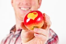 Free Youn Man With An Apple With Hearts Royalty Free Stock Images - 17590129