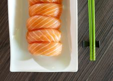 Sushi With Green Chopsticks Royalty Free Stock Photos