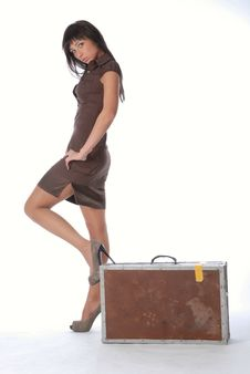 Brunette With A Suitcase Royalty Free Stock Images