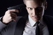 Young Attractive Macho In Suit With Gun Royalty Free Stock Photos