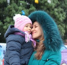 Free Mom And Girl Near A Christmas Tree Stock Photography - 17593462