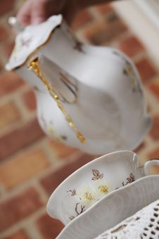 Porcelain Jug And Elegant Cup. Royalty Free Stock Photo