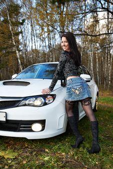 Free Brunette Girl And Stylish White Car Stock Image - 17594861
