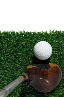 Golf Ball And Driver On Grass Stock Photos