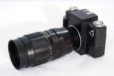 Free SLR Camera With A Big Lens. Royalty Free Stock Photography - 17598537