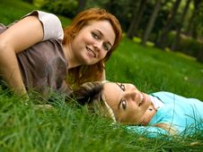 Free Two Girls Resting On The Grass Royalty Free Stock Photos - 17602238