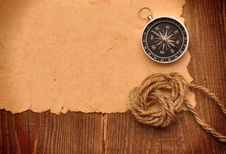 Free Compass And Rope On Background Royalty Free Stock Image - 17605476