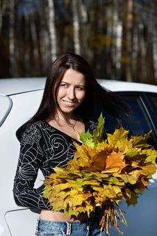 Free Romantic Girl With Yellow Leaves And White Car Stock Images - 17607504