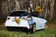 Free Joyful Girl With Yellow Leaves And White Car Stock Photography - 17607552