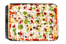Pizza In Baking Tray Waiting For Oven Royalty Free Stock Images