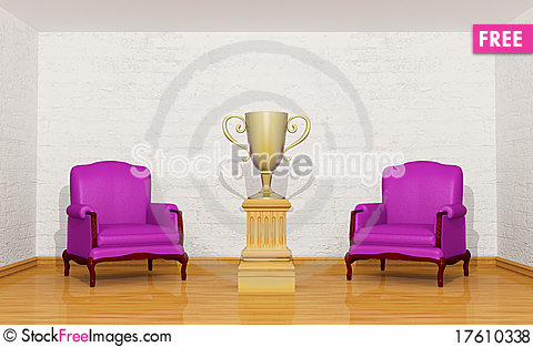 Golden trophy cup on the pedestal in room Stock Photo