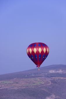 Free Red Hot Air Balloon Flying In Mountains Stock Photography - 17614312