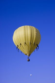 Free Yellow Hot Air Balloon Flying In Blue Sky Royalty Free Stock Image - 17614316