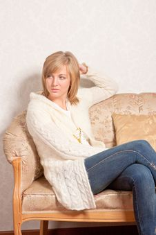 Free Young Woman Sits On A Sofa Stock Photography - 17615032