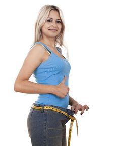 Free Young Happy Girl Measuring Her Waist Royalty Free Stock Photo - 17615145