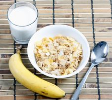 Free Cereal In Bowl With Milk And Banana Royalty Free Stock Image - 17615636