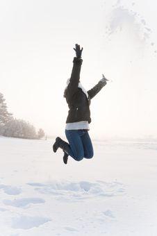 Girl Jumping At Snow Royalty Free Stock Photography