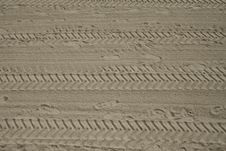 Free Footprints And Tyre Tracks In Sand Stock Images - 17619394