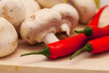 Red Hot Chili Pepper And Mushrooms Stock Photos