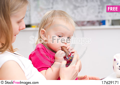 Free Adorable Baby Eat Chocolate With Mother Stock Image - 17629171