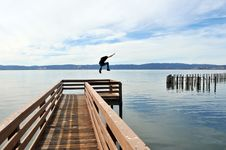 Free Jumping Off A Pier Into The Ocean Stock Image - 17621251