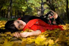 Free Young Woman In Autumn Park On Ground Royalty Free Stock Image - 17628746
