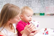 Young Mother Drink Tea With Daughter Royalty Free Stock Image