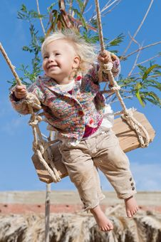 Free Little Happy On A Swing Royalty Free Stock Images - 17629619