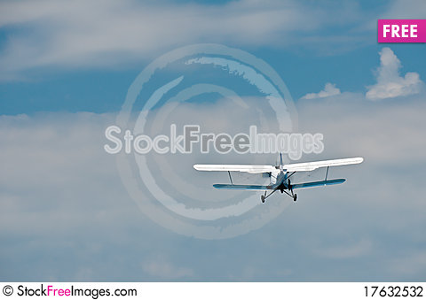 Flying away small blue-white plane Stock Photo